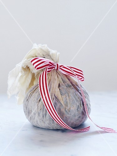 Christmas pudding in a cloth tied with a bow