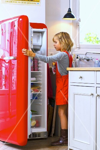 Little girl opening refrigerator
