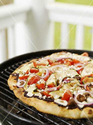 Greek pizza on a barbecue