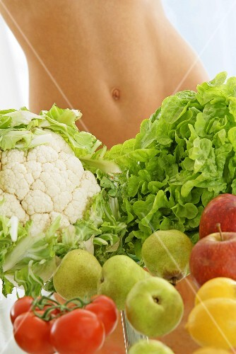 Fruit & vegetables in front of someone's bare midriff