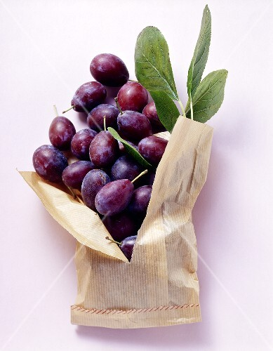 Fresh damsons in a paper bag