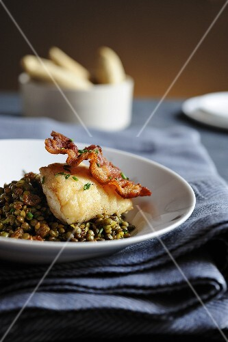 Cod with bacon on a lentil salad