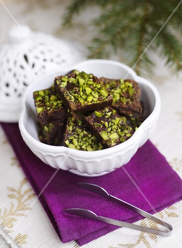 Chocolates with chopped pistachios for Christmas