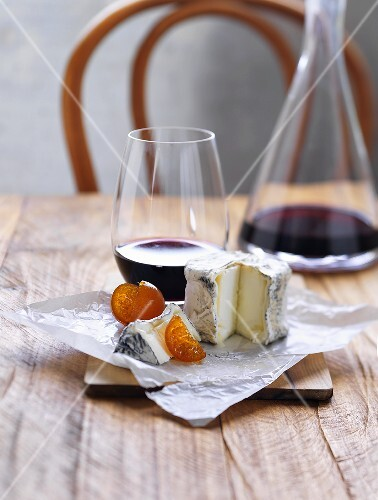 Still life with soft cheese and red wine