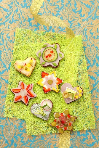Various canapes with ham, cheese and vegetables
