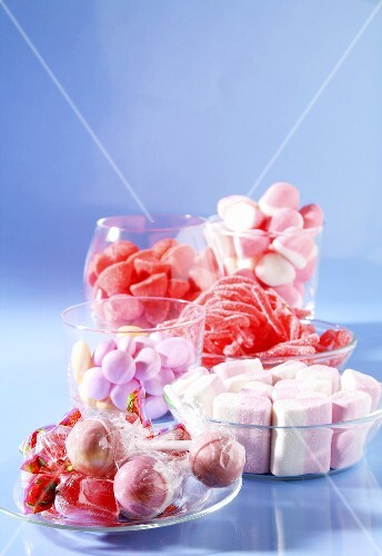 Assorted pink sweets in glass dishes