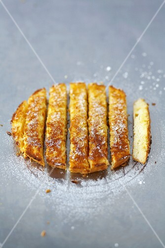 Orange sponge cake with almonds, cut into strips