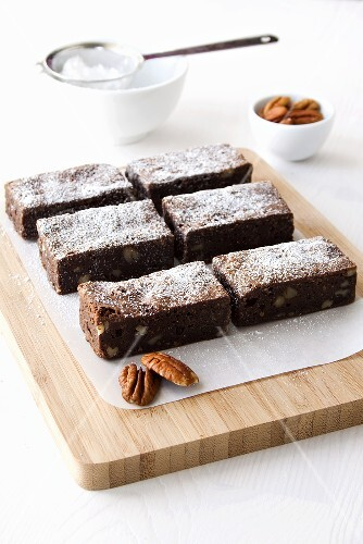 Pecan brownies with icing sugar