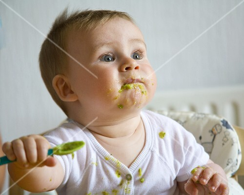 Baby eating pureed vegetables
