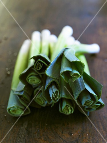 Fresh leeks on wooden background