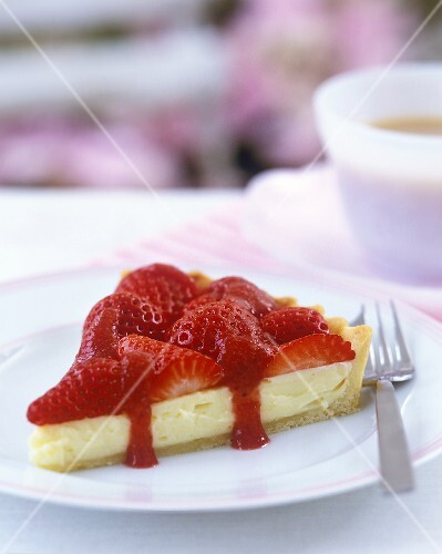 Piece of white chocolate tart with strawberries