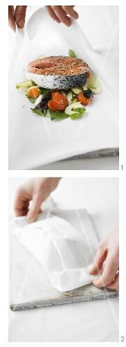 Preparing salmon and vegetables en papillote