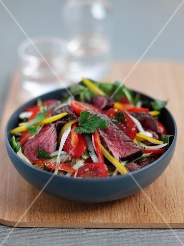 Vegetable salad with beef strips