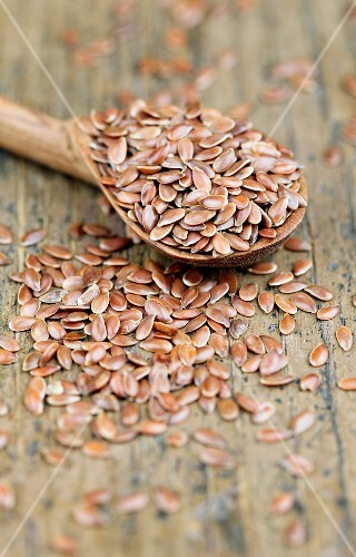 Flaxseeds with a wooden spoon