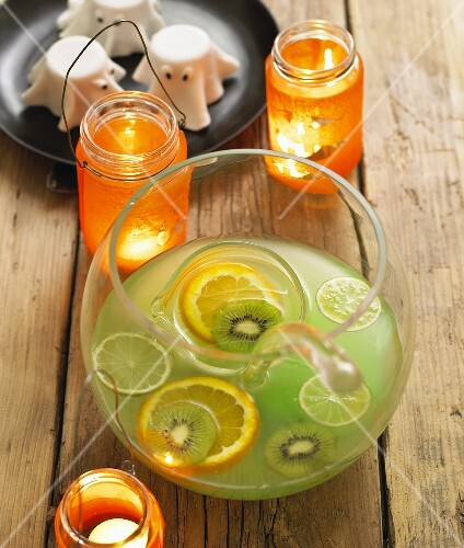 Punch with kiwi fruit and citrus fruit for Halloween
