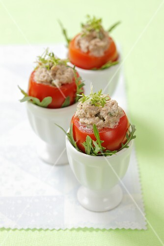 Tuna-stuffed tomatoes in egg cups