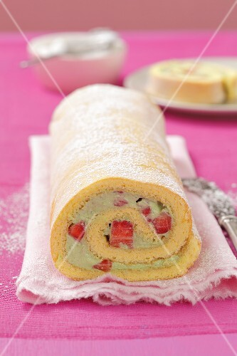 A sponge roll with a strawberry and basil cream filling