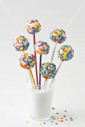 Cake pops with white icing and colourful sugar strands
