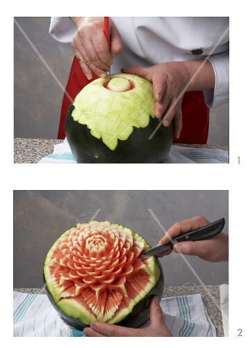A watermelon being carved