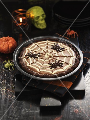 Chocolate pie decorated with spiders for Halloween