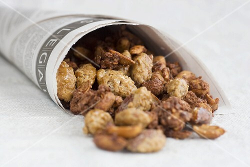 Roasted almonds and peanuts in paper bags