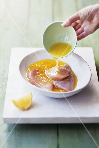 Chicken breast marinating in lemon marinade