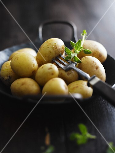 New potatoes and a fork