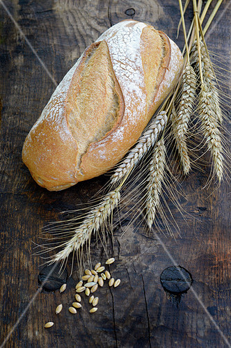 Farmhouse bread and wheat ears and grains