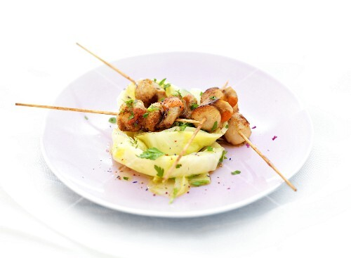 Petoncle scallop brochettes and blanched white cabbage leaves