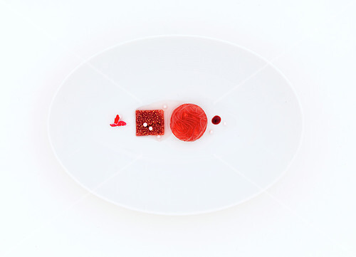 Red food composition on a white plate