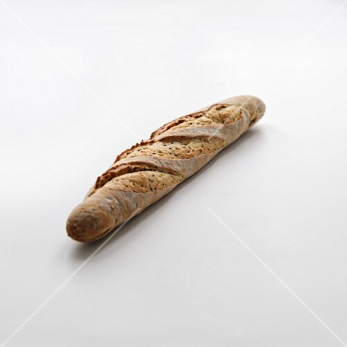 Linseed baguette on a white background