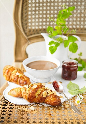 Marzipan and almond croissants, boiling hot cup of chocolate