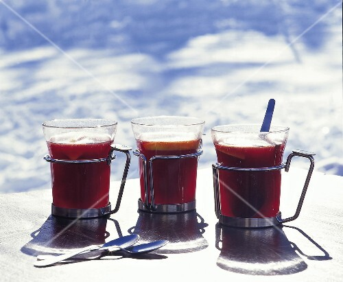 Mugs of mulled wine with cinnamon