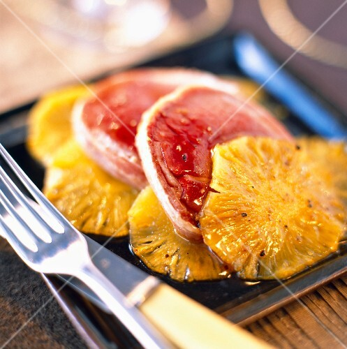 Slices of roast ostrich with pineapple