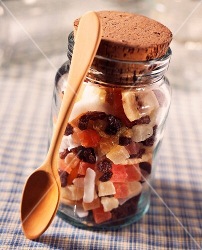 Jar of dried fruit with wooden spoon