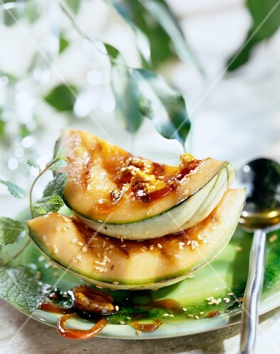 grilled melon with caramelised walnuts and sesame seeds