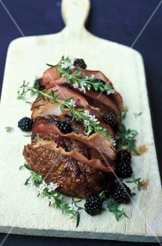 Roast beef with bacon,thyme in flower and blackberries
