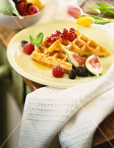 A waffle with fresh figs and berries
