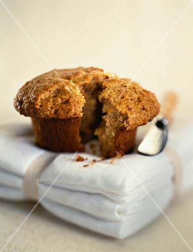 A muffin with a piece broken off