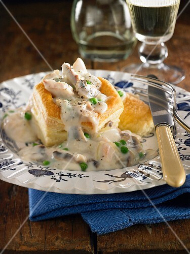 Chicken and mushroom puff pastry pie with peas