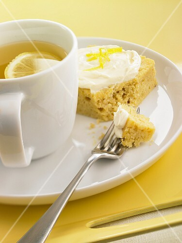 Tea with lemon and a slice of lemon cake