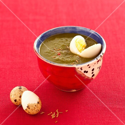 Vegetable soup with a quail's egg