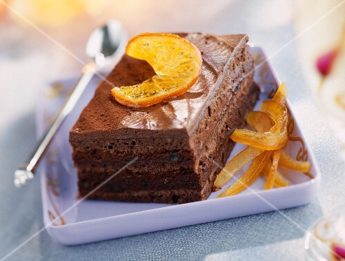 Opéra slice with chocolate and candid oranges