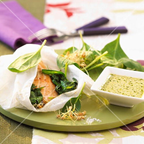 Trout with spinach sprouts cooked in parchment paper