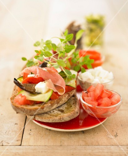 Sunny open sandwich with grilled vegetables,feta and raw ham