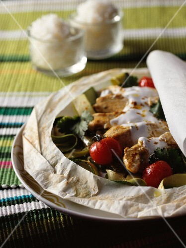 Chicken with coconut milk on parchment paper