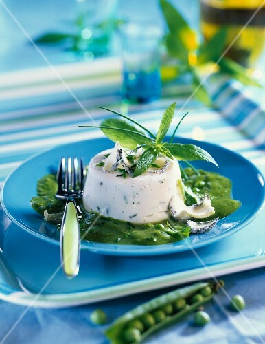 Cream cheese flan with pea sauce