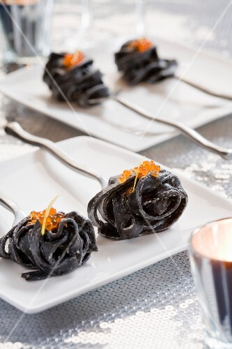 Squid ink tagliatelles with salmon