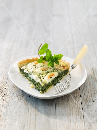 Slice of spinach and goat's cheese savoury tart