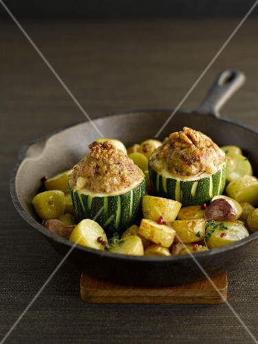 Stuffed zucchinis with walnuts and pan-fried potatoes